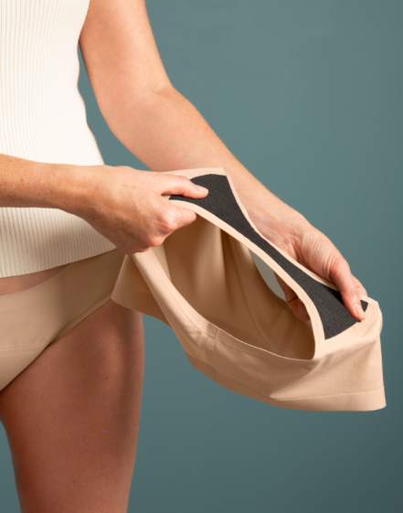 Knix Underwear Review: Do Period Panties Work? An honest review featured by top Seattle lifestyle blogger, Marcie in Mommyland: Image of a woman holding knix period panties in her hand